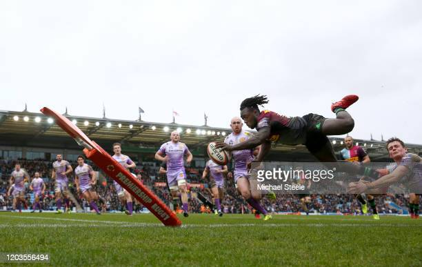 Gabriel Ibitoye of Harlequins dives over to score a try during the semifinal of the Premiership Rugby Cup between Exeter Chiefs and Harlequins at...