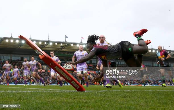 Gabriel Ibitoye of Harlequins dives over to score a try during the semi-final of the Premiership Rugby Cup between Exeter Chiefs and Harlequins at...