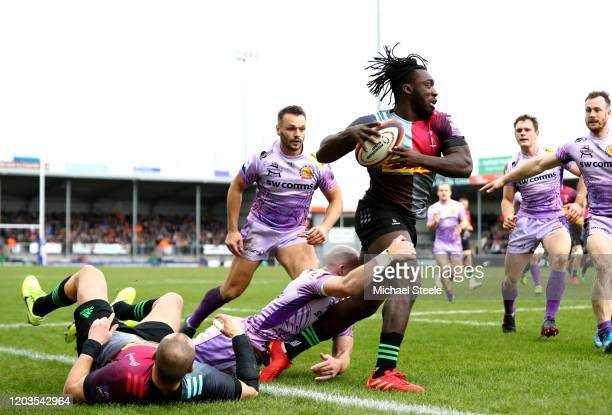 Gabriel Ibitoye of Harlequins is tackled by Max Bodilly of Exeter Chiefs during the semi-final of the Premiership Rugby Cup between Exeter Chiefs and...