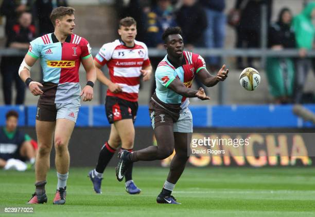 Gabriel Ibitoye of Harlequins passes the ball in the match against Gloucester during the Singha Premiership Rugby 7s Series Day One at Franklin's...