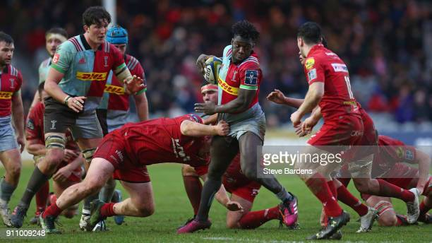 Gabriel Ibitoye of Harlequins takes ion the Scarlets defence during the AngloWelsh Cup match between Harlequins and Scarlets at Twickenham Stoop on...