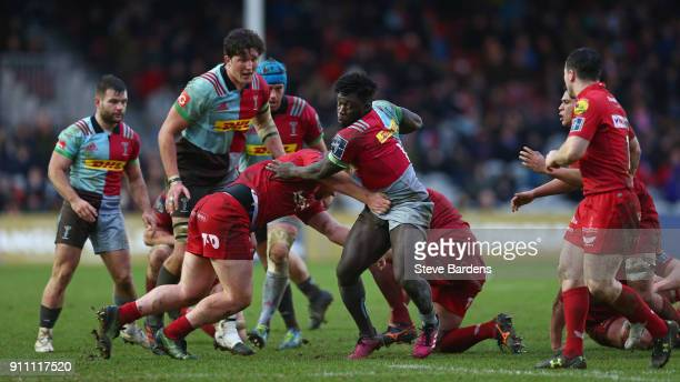 Gabriel Ibitoye of Harlequins takes on the Scarlets defence during the AngloWelsh Cup match between Harlequins and Scarlets at Twickenham Stoop on...