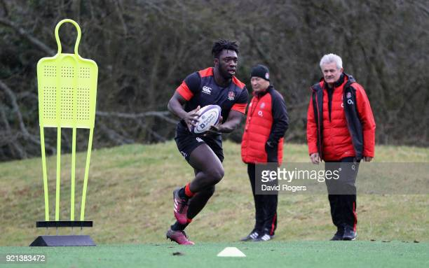Gabriel Ibitoye runs with the ball during the England training session held at Pennyhill Park on February 20 2018 in Bagshot England