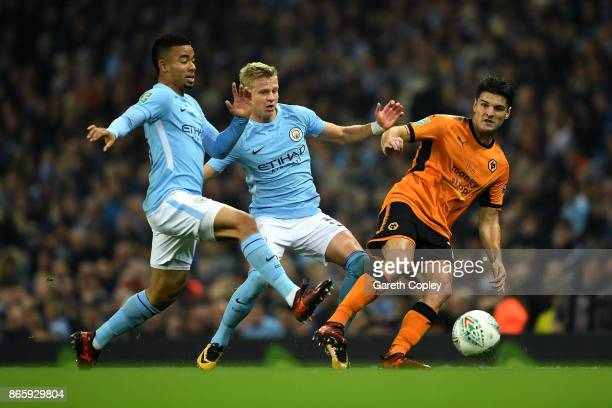 Gabriel Jesus and Alexander Zinchenko of Manchester City chase down Ben Marshall of Wolverhampton Wanderers during the Carabao Cup Fourth Round match...