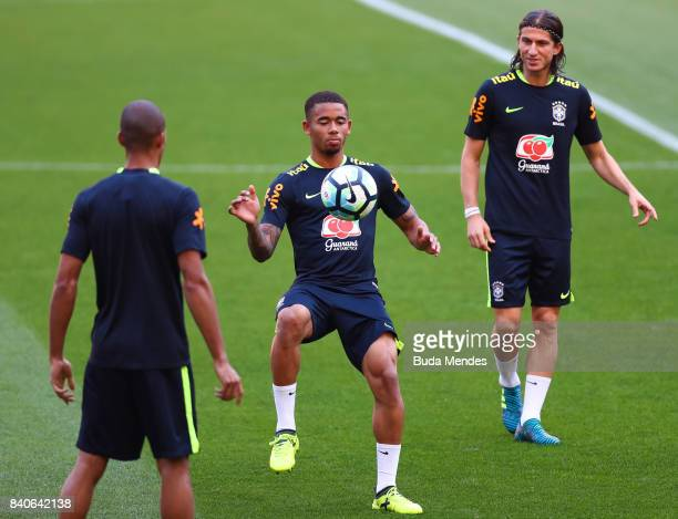 Gabriel Jesus and Filipe Lus take part in a training session at the Beira Rio Stadium on August 29 2017 in Porto Alegre Brazil ahead of their 2018...
