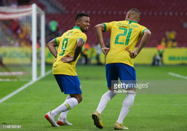 Gabriel Jesus and Richarlison of Brazil celebrate a scored goal during the International Friendly Match between Brazil and Honduras at Beira Rio...