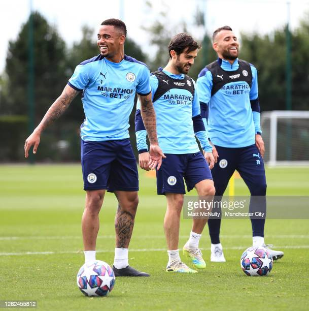 Gabriel Jesus Bernardo Silva and Nicolas Otamendi of Manchester City in action during a training session at Manchester City Football Academy on July...