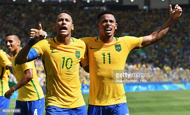 Gabriel Jesus celebrates scoring his goal with Neymar of Brazil during the Olympic Men's semi final match between Brazil and Honduras at Maracana...
