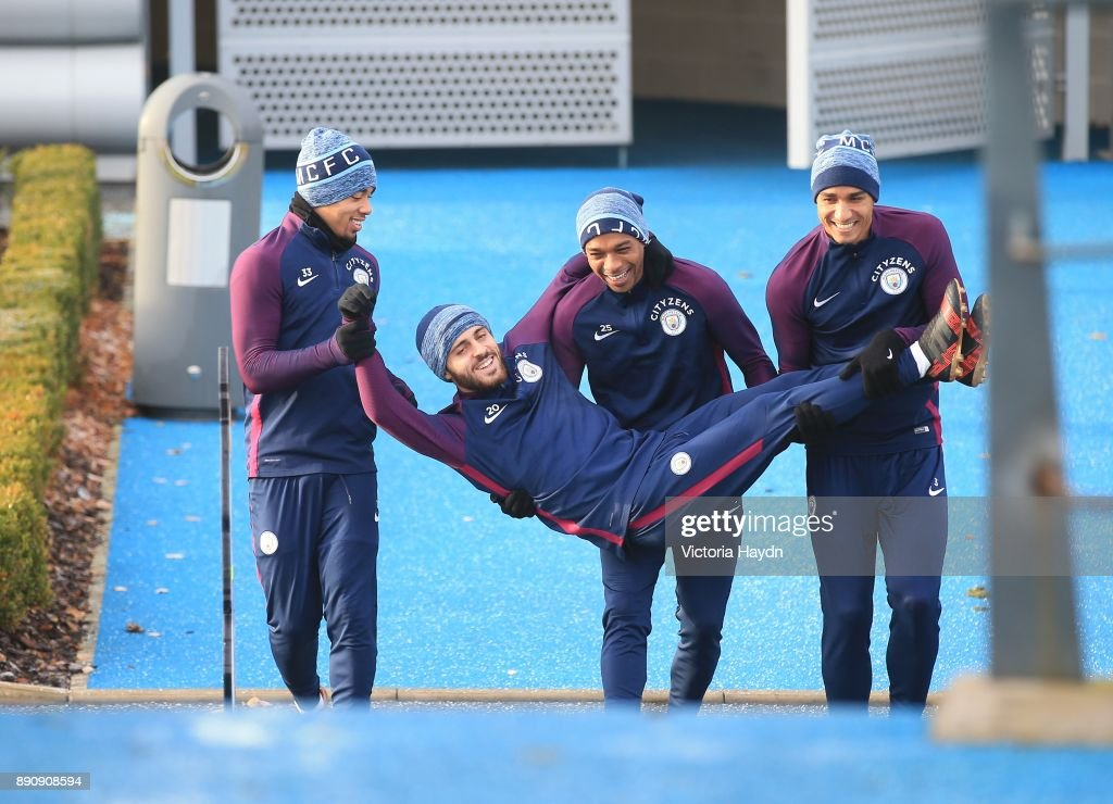 Gabriel Jesus, Fernandinho and Danilo carry Bernardo Silva out to training at Manchester City Football Academy on December 12, 2017 in Manchester, England.