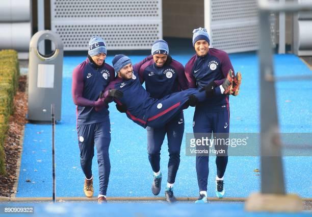 Gabriel Jesus Fernandinho and Danilo carry Bernardo Silva out to training at Manchester City Football Academy on December 12 2017 in Manchester...