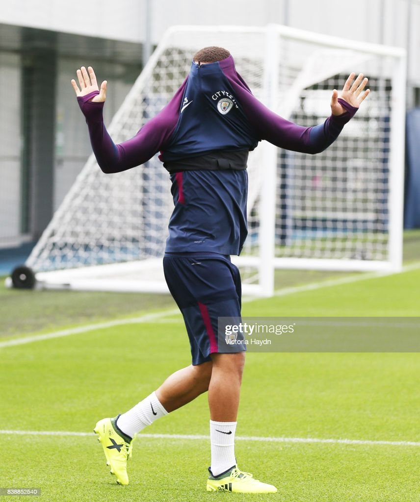 Gabriel Jesus gets stuck in his jumper during training at Manchester City Football Academy on August 25, 2017 in Manchester, England.