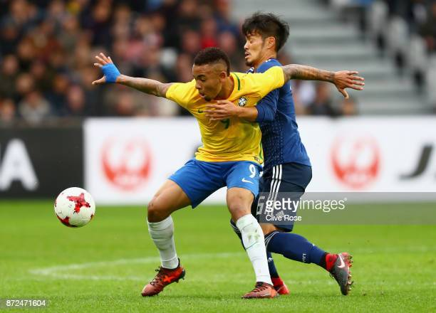 Gabriel Jesus of Brazil and Hotaru Yamaguchi of Japan battle for possession during the international friendly match between Brazil and Japan at Stade...