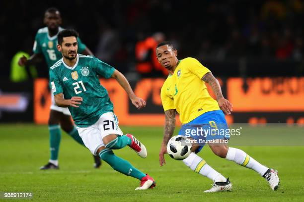 Gabriel Jesus of Brazil and Ilkay Gundogan of Germany in action during the International friendly between Germany and Brazil at Olympiastadion on...