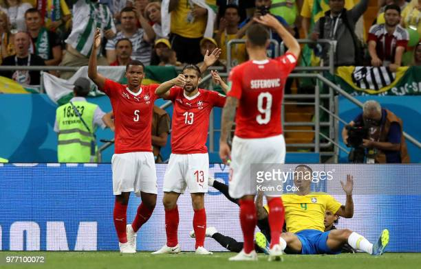 Gabriel Jesus of Brazil argues with Manuel Akanji and Ricardo Rodriguez during the 2018 FIFA World Cup Russia group E match between Brazil and...