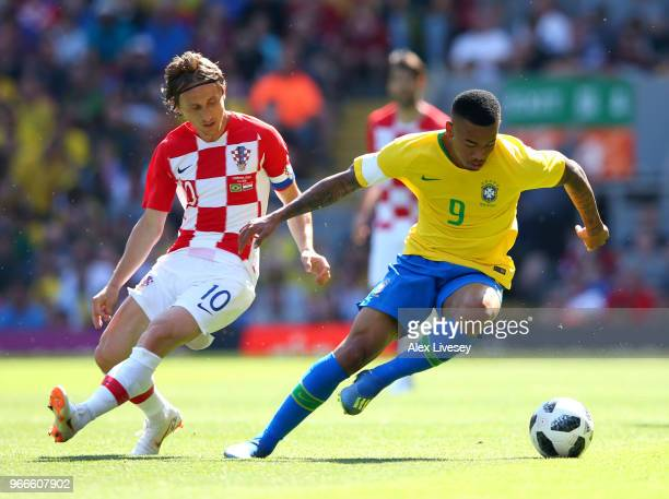 Gabriel Jesus of Brazil attempts to get away from Luke Modric of Croatia during the International Friendly match between Croatia and Brazil at...