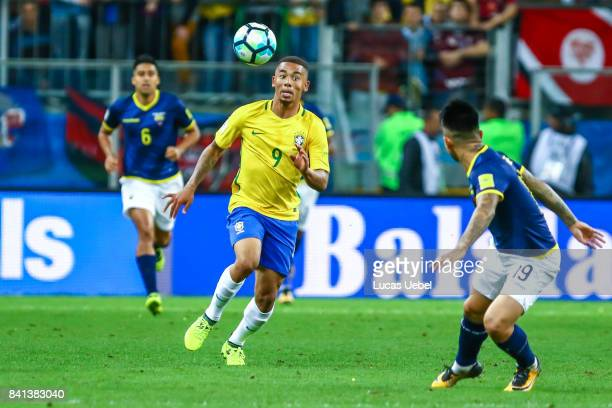 Gabriel Jesus of Brazil battles for the ball against Cristian Ramirez of Equador during the match Brazil v Equador 2018 FIFA World Cup Russia...