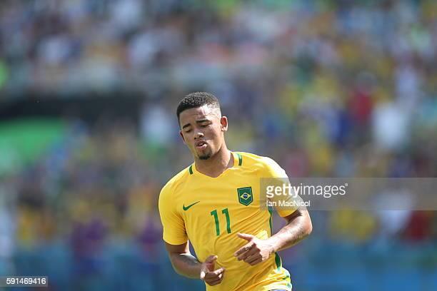 Gabriel Jesus of Brazil celebrates after he scores Brazil's third goal during the Semi Final match between Brazil and Honduras at Maracana Stadium on...