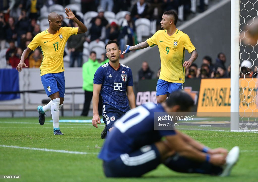 Gabriel Jesus of Brazil celebrates his goal with Fernandinho (left) during the international friendly match between Brazil and Japan at Stade Pierre-Mauroy on November 10, 2017 in Lille, France.