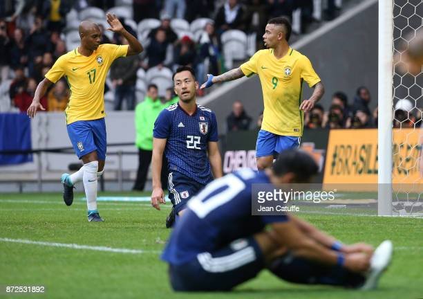 Gabriel Jesus of Brazil celebrates his goal with Fernandinho during the international friendly match between Brazil and Japan at Stade PierreMauroy...