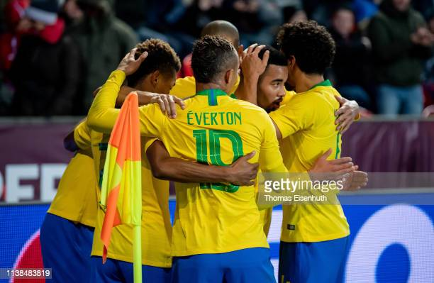 Gabriel Jesus of Brazil celebrates with teammates after scoring his team's third goal during the international friendly match between the Czech...