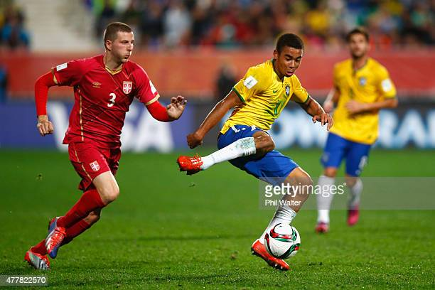 Gabriel Jesus of Brazil clears under pressure from Nemanja Antonov of Serbia during the FIFA U20 World Cup Final match between Brazil and Serbia at...