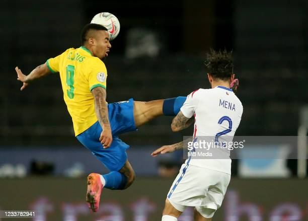Gabriel Jesus of Brazil competes for the ball with Eugenio Mena of Chile ,during the Quarterfinal match between Brazil and Chile as part of Conmebol...