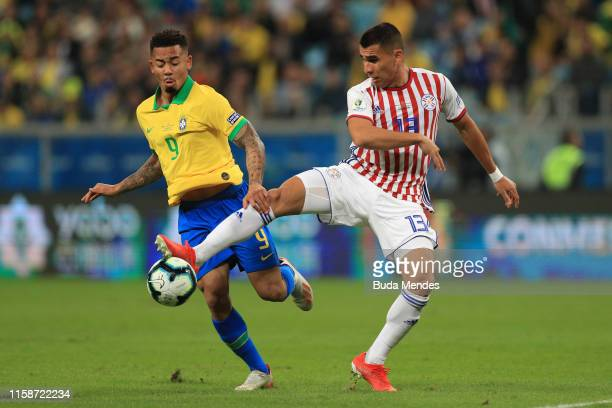 Gabriel Jesus of Brazil fights for the ball with Junior Alonso of Paraguay during the Copa America Brazil 2019 quarterfinal match between Brazil and...