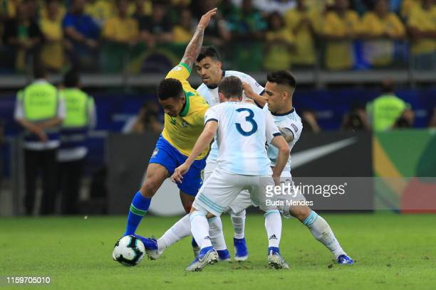 Gabriel Jesus of Brazil fights for the ball with Lautaro Martinez Nicolas Tagliafico and Marcos Acuña of Argentina during the Copa America Brazil...