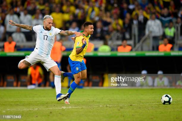 Gabriel Jesus of Brazil fights for the ball with Nicolas Otamendi of Argentina during the Copa America Brazil 2019 Semi Final match between Brazil...
