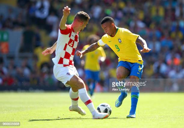 Gabriel Jesus of Brazil is challenged by Ivan Perisic of Croatia during the International Friendly match between Croatia and Brazil at Anfield on...