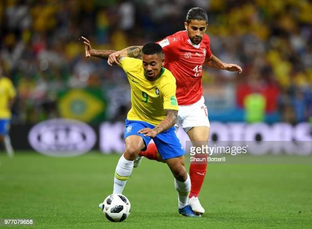 Gabriel Jesus of Brazil is challenged by Ricardo Rodriguez of Switzerland during the 2018 FIFA World Cup Russia group E match between Brazil and...