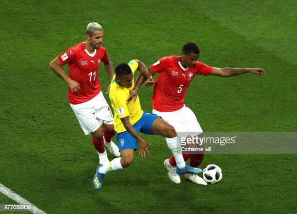 Gabriel Jesus of Brazil is challenged by Valon Behrami of Switzerland and Manuel Akanji of Switzerland during the 2018 FIFA World Cup Russia group E...