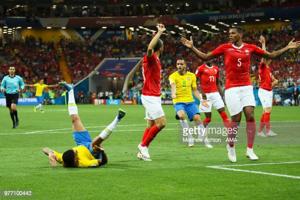 Gabriel Jesus of Brazil is challenged in the penalty area by Manuel Akanji of Switzerland during the 2018 FIFA World Cup Russia group E match between...