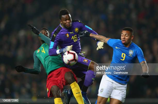 Gabriel Jesus of Brazil is tackled by Andre Onana and Yaya Banana of Cameroon during the International Friendly match between Brazil and Cameroon at...