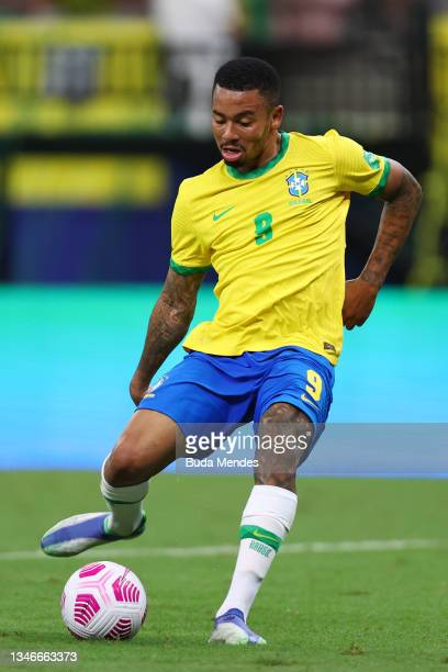 Gabriel Jesus of Brazil kicks the ball during a match between Brazil and Uruguay as part of South American Qualifiers for Qatar 2022 at Arena...