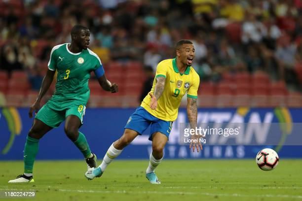 Gabriel Jesus of Brazil reacts after being tackled by Kalidou Koulibaly of Senegal during the international friendly match between Brazil and Senegal...