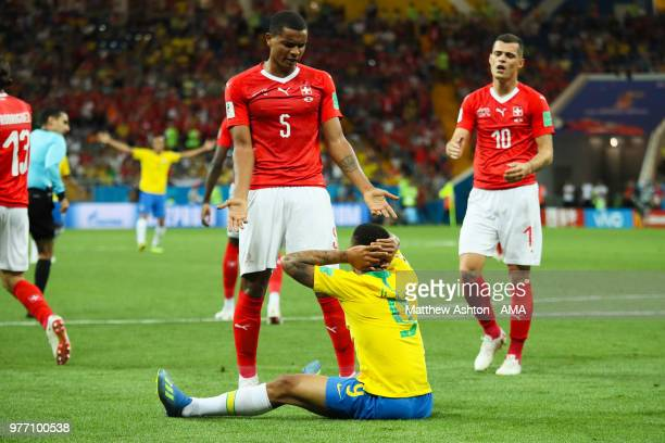 Gabriel Jesus of Brazil reacts to a challenge in the penalty area by Manuel Akanji of Switzerland during the 2018 FIFA World Cup Russia group E match...