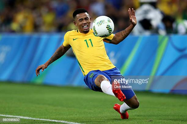 Gabriel Jesus of Brazil runs with the ball during the Men's Football Final between Brazil and Germany at the Maracana Stadium on Day 15 of the Rio...