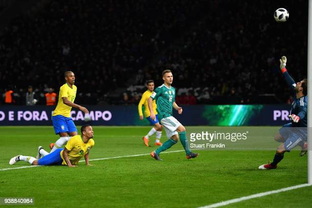 Gabriel Jesus of Brazil scores his sides first goal during the International friendly between Germany and Brazil at Olympiastadion on March 27 2018...