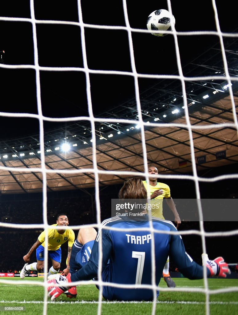 Gabriel Jesus of Brazil scores his sides first goal past goalkeeper Kevin Trapp of Germany during the International friendly between Germany and Brazil at Olympiastadion on March 27, 2018 in Berlin, Germany.