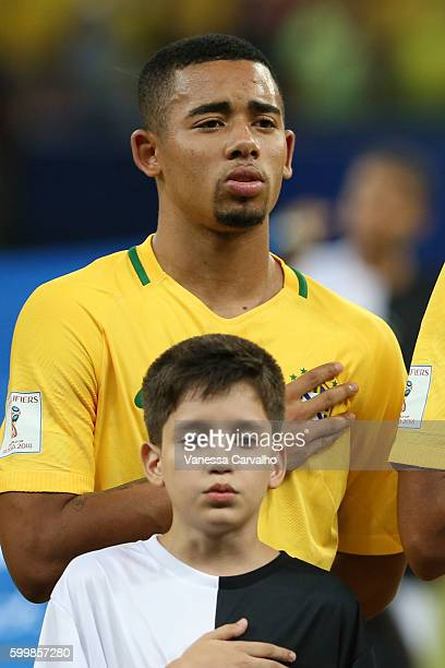 Gabriel Jesus of Brazil sings the national anthem during a match between Brazil and Colombia as part of FIFA 2018 World Cup Qualifiers at Arena...