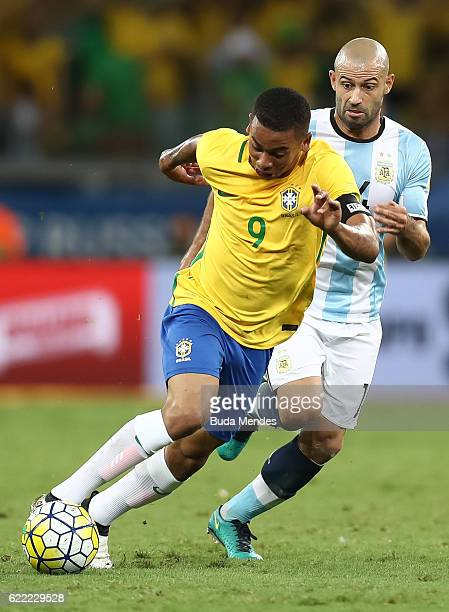 Gabriel Jesus of Brazil struggles for the ball with Javier Mascherano of Argentina during a match between Brazil and Argentina as part of 2018 FIFA...
