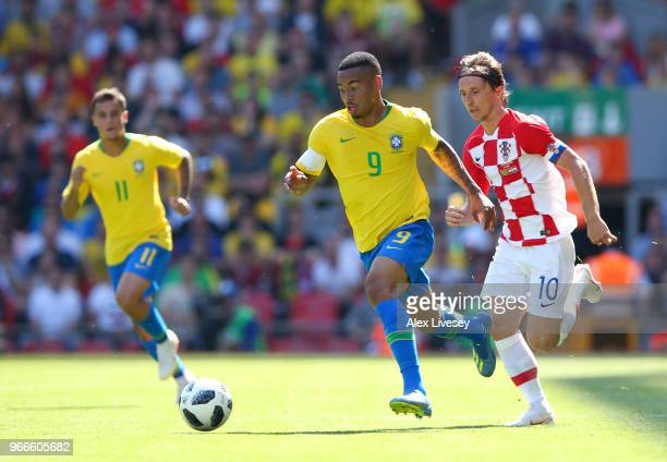 Gabriel Jesus of Brazil takes the ball away from Luke Modric of Croatia during the International Friendly match between Croatia and Brazil at Anfield...