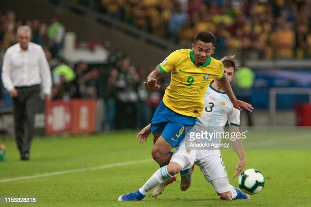 Gabriel Jesus of Brazil vies for the ball with Tagliafico of Argentina during the Conmebol America Cup Brazil 2019 match between Brazil and Argentina...