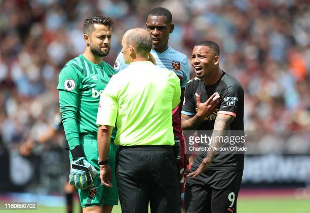 Gabriel Jesus of Man City argues with referee Mike Dean after his goal his disallowed by VAR during the Premier League match between West Ham United...