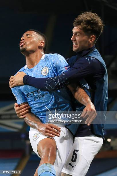 Gabriel Jesus of Man City runs into teammate John Stones of Man City as he celebrates after scoring their 2nd goal during the UEFA Champions League...