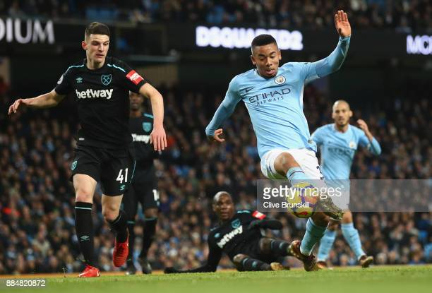 Gabriel Jesus of Manchester City and Declan Rice of West Ham United battle for possession during the Premier League match between Manchester City and...