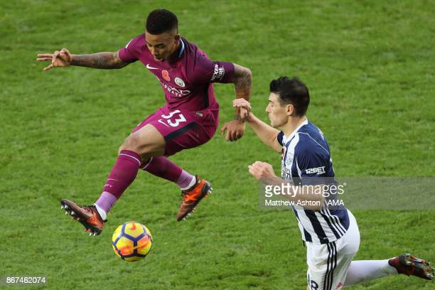 Gabriel Jesus of Manchester City and Gareth Barry of West Bromwich Albion during the Premier League match between West Bromwich Albion and Manchester...