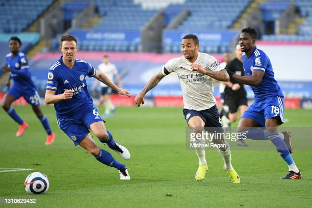 Gabriel Jesus of Manchester City and Jonny Evans of Leicester City chase the ball during the Premier League match between Leicester City and...