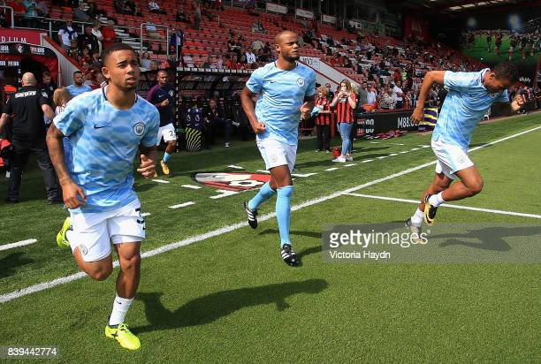 Gabriel Jesus of Manchester City and Vincent Kompany of Manchester City walk out to warm up prior to the Premier League match between AFC Bournemouth...